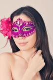 Beautiful woman in a carnival mask Stock Images