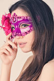 Beautiful woman in a carnival mask Stock Photography
