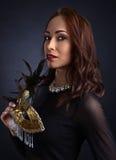 Beautiful woman with carnival mask Stock Photo