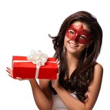 Beautiful Woman with the Carnival mask and gift Royalty Free Stock Photography
