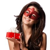 Beautiful Woman with the Carnival mask and gift Stock Image