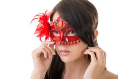 Beautiful woman in a carnival mask stock photos