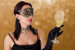 Beautiful woman in carnival mask. Royalty Free Stock Images