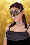 Beautiful woman in carnival mask. Stock Image