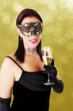 Beautiful woman in carnival mask. Stock Photos