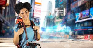 Beautiful woman carrying backpack and camera travelling in city Royalty Free Stock Photography