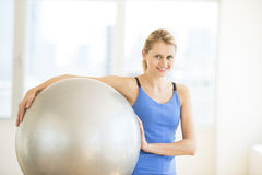 Beautiful Woman Carrying Fitness Ball At Gym Royalty Free Stock Image