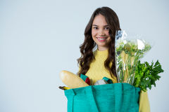Beautiful woman carrying grocery bag Royalty Free Stock Image