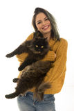 Beautiful woman carrying her cat Royalty Free Stock Image