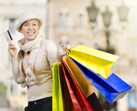 Beautiful woman carrying a lot of shopping bags Stock Images