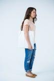 Beautiful woman carrying shopping bag Stock Photos