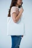 Beautiful woman carrying shopping bag Stock Photography