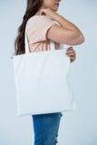Beautiful woman carrying shopping bag Royalty Free Stock Photos