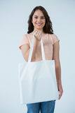 Beautiful woman carrying shopping bag Royalty Free Stock Photo