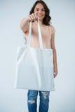 Beautiful woman carrying shopping bag Stock Images
