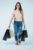 Beautiful woman carrying shopping bags Royalty Free Stock Images