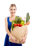 Beautiful woman carrying vegetables Royalty Free Stock Image