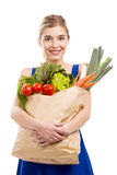 Beautiful woman carrying vegetables Royalty Free Stock Photo