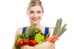 Beautiful woman carrying vegetables Stock Photo