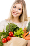 Beautiful woman carrying vegetables Royalty Free Stock Photos