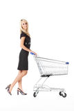 Beautiful woman with cart royalty free stock photo