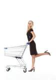 Beautiful woman with cart stock image