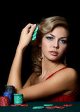 The beautiful woman with casino chips royalty free stock photo