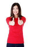 Beautiful woman in casual clothes gesturing thumbs up. Royalty Free Stock Photography