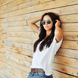Beautiful woman in casual clothes wearing sunglasses Royalty Free Stock Image