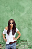 Beautiful woman in casual clothes wearing sunglasses Stock Photography