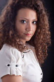 Beautiful woman with casual make up and curly hair Stock Photo