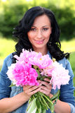 Beautiful woman in casual with peonies Royalty Free Stock Photo