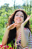 Beautiful woman catches soap bubbles stock photos