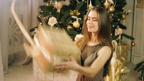 Beautiful woman catching box with christmas gift stock footage