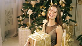 Beautiful woman catching box with christmas surprise gift stock footage