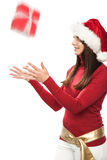 Beautiful woman catching a Christmas gift Stock Photography