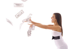 Beautiful woman catching money Stock Image