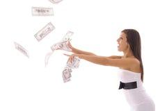 Beautiful woman catching money Stock Image