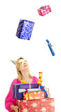 A beautiful woman catching some gifts. For christmas Royalty Free Stock Photography