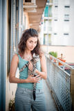 Beautiful woman with cats Stock Photo