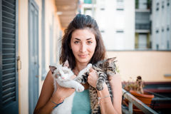 Beautiful woman with cats Stock Images