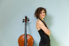 Beautiful woman with cello. Portrait of young cellist, interior stock photos