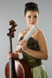 Beautiful woman with cello and score Stock Images