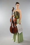 Beautiful woman with cello and score Royalty Free Stock Image