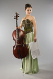 Beautiful woman with cello and score Stock Photo