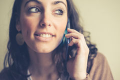 Beautiful woman on cellphone calling Stock Image