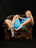 Beautiful woman in chair. Beautiful woman in blue dress Royalty Free Stock Photos