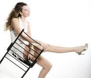 Beautiful woman on a chair Stock Image