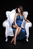 Beautiful woman in a chair Stock Images