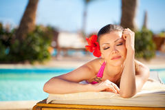 Beautiful woman on a chaise lounge Stock Photos